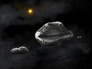 Artistic representation of the triple asteroid system showing the large 270-km asteroid Sylvia surrounded by its two satellites, Romulus and Remus. The differentiated interior of the asteroid is shown through a cutaway diagram. The primary asteroid of the system may have a dense, regularly-shaped core, surrounding by a fluffy or fractured material. The two moons are shown to be strongly elongated, and composed of two lobes, as suggested by the recently observed occultation data by the satellite Romulus (credit: Danielle Futselaar/SETI Institute)